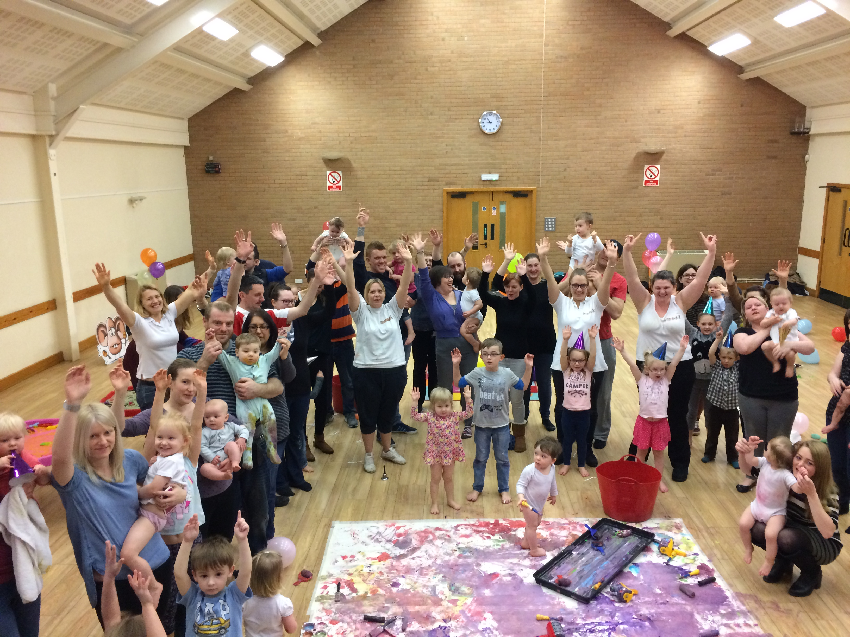 parents and children enjoying messy senses messy play birthday party